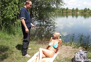 Nude passion by the lake with a busty teen keen to drag inflate dick