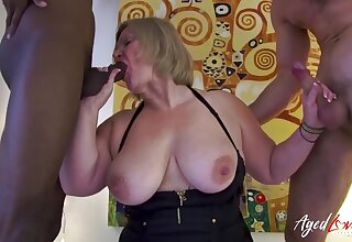 Horny of age lady from Britain is playing with two handy studs at once enjoying hardcore sexual intercourse