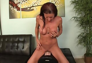 Charmer near slutty tendencies sits on the top of Sybian machine increased by wanks