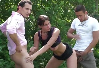 Babe gets fucked by two guys outside
