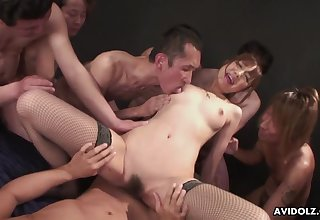 Japanese cutie in fishnets rides a dick for an audience