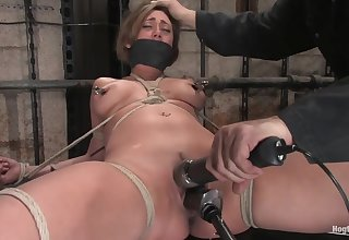 Tied up BDSM slut made to ride a mounted dildo. Full video.