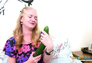 Sex-starved old woman Lily May tries to satisfy herself with a huge cucumber
