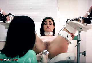 Crazy nurse, Minerva is toying fro Valentina Bianco, while they are alone in the office